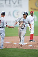 Mahoning Valley Scrappers first baseman Ulysses Cantu (8) shakes manager Luke Carlin (11) hand after hitting a home run during the second game of a doubleheader against the Auburn Doubledays on July 2, 2017 at Falcon Park in Auburn, New York.  Mahoning Valley defeated Auburn 3-2.  (Mike Janes/Four Seam Images)