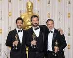 Grant Heslov, Ben Affleck and George Clooney in the press room at the 85th Academy Awards, held at the Dolby Theater in Los Angeles, CA. February 24, 2013