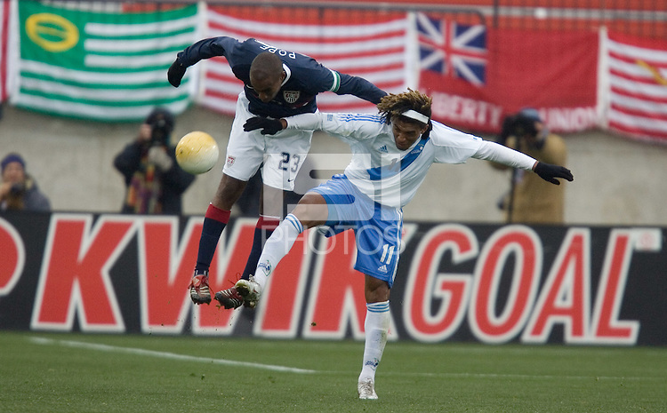 Eddie Pope goes up for a header over Guillermo Ramirez at Pizza Hut Park in Frisco, Texas, Sunday, Feb. 19, 2005.  USA won 4-0.