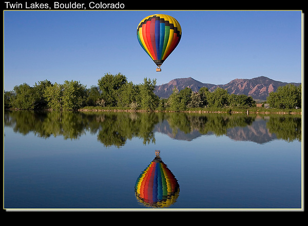 Hot air balloons are a wonderful subject to photograph. They're colorful and move just fast enough to be exciting.  The perfect reflection makes the shot, lucky for me.