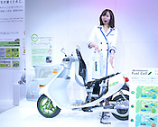 A model introduces the energy pack for the Suzuki scooter.