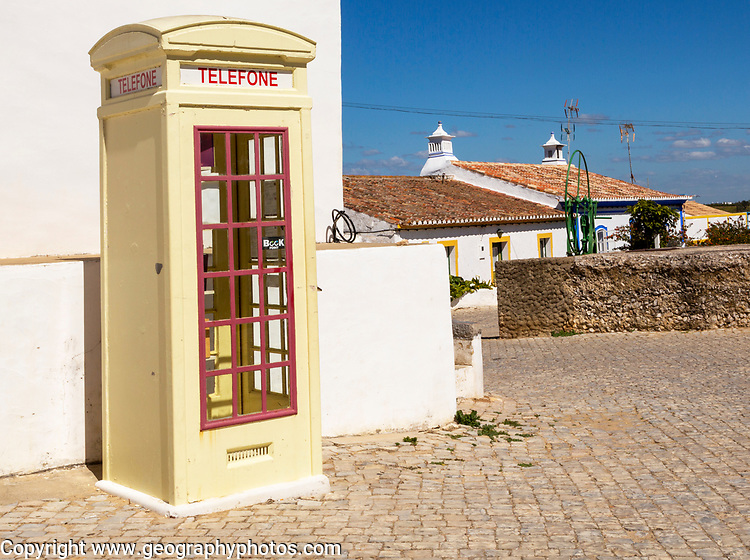 Old fashioned Telephone Telefone box kiosk in street of traditional Portuguese village, Cacela Velha, Algarve, Portugal, Southern Europe