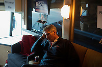 Senator Scott Brown (R-MA) rests between stops on his campaign bus between campaign stops in Framingham and Lowell, Massachusetts, USA, on Thurs., Nov. 2, 2012. Senator Scott Brown is seeking re-election to the Senate.  His opponent is Elizabeth Warren, a democrat.