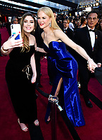 Nicole Kidman takes a selfie with fan at the Oscars on Sunday, March 4, 2018, at the Dolby Theatre in Los Angeles. (Photo by Charles Sykes/Invision/AP)