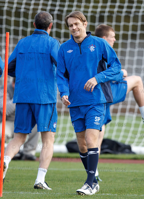 Sasa Papac forces a smile as he tries to be a jolly japester at training, big Jig he is not...