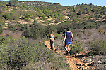 Two women walking mountain landscape near Xalo or Jalon, Marina Alta, Alicante province, Spain