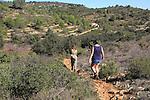 Two women walking mountain landscape near Xalo or Jalon, Marina Alta, Alicante province, Spain