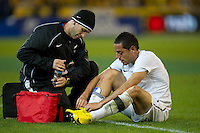 MELBOURNE, AUSTRALIA - MAY 24, 2010: Leo Bertos of New Zealand receives treatment from a tackle at the FIFA World Cup farewell match between Australia and New Zealand at the Melbourne Cricket Ground, 24 May, 2010 in Melbourne, Australia. Photo by Sydney Low / www.syd-low.com