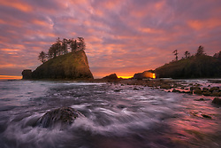 The diagonals of the surf from  an incoming tide complement an amazing sunset on the Olympic Coast.<br />