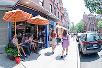 Al fresco dining in the Nolita neighborhood of New York on Saturday, May 26, 2012.  (© Frances M. Roberts)