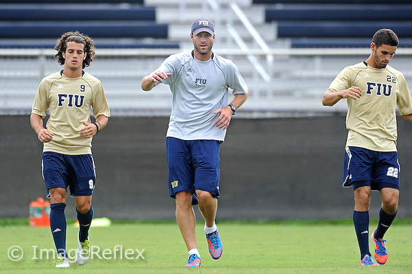 16 August 2012:  FIU Assistant Coach Kevin Nylen puts players through drills prior to the match.  The FIU Golden Panthers and Barry University Buccaneers played to a tie, 2-2, at Buccaneer Field in Miami Shores, Florida.
