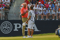 Stewart Cink (USA) shakes hands with his caddie/son after sinking his putt on 18 during 4th round of the 100th PGA Championship at Bellerive Country Club, St. Louis, Missouri. 8/12/2018.<br /> Picture: Golffile | Ken Murray<br /> <br /> All photo usage must carry mandatory copyright credit (&copy; Golffile | Ken Murray)
