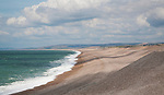 Sweeping bay and shingle beach of Chesil Beach from Chiswell, Isle of Portland, Dorset, England, UK