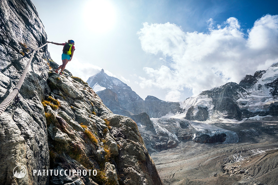The Chamonix to Zermatt Glacier Haute Route. In late August 2017, we ran the tour in mountain running gear, running shoes, and all the necessary glacier travel and crevasse rescue gear. On the last day, to get out of glacier trrain and back on to smooth running trails, a small section of steeprock must be climbed with cables to reach the Schönbiel Hut. On the way to Zermatt, with the Matterhorn and Dent d'Hérens in the background.