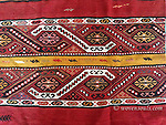 A large antique Anatolian yoruk nomadic chuval or çuval storage bag (opened) from the Taurus Mountains. Wool  with soumak embroidered panels (white cotton highlights) and striped kilim skirts. Stunnign Yellow, red and black. Color faded at one end and slight color run. ATP-804, 804,