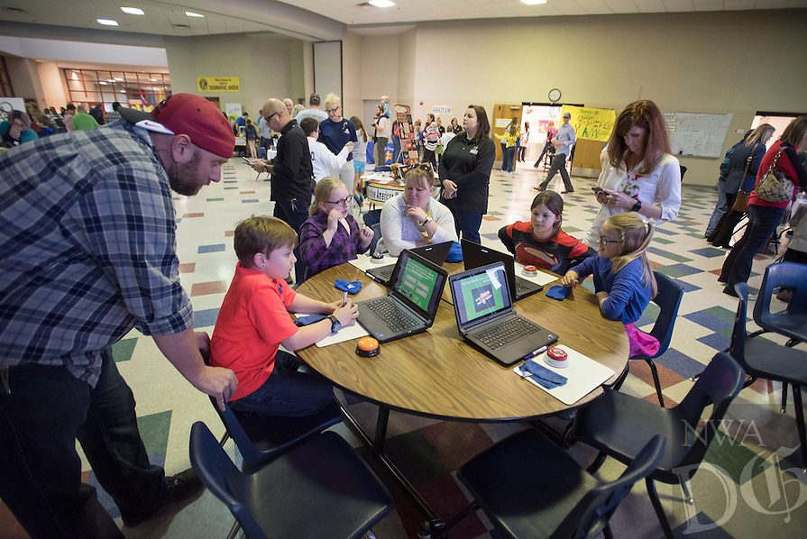 NWA Democrat-Gazette/J.T. WAMPLER Parents and children test their math skills Thursday Mar. 10, 2016 at Old High Middle School's  Arts and Academic Night. School groups and community partners set up educational displays for visitors to enjoy.