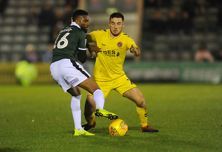 Plymouth Argyle's Joel Grant under pressure from Fleetwood Town's Lewis Coyle<br /> <br /> Photographer Kevin Barnes/CameraSport<br /> <br /> The EFL Sky Bet League One - Plymouth Argyle v Fleetwood Town - Saturday 24th November 2018 - Home Park - Plymouth<br /> <br /> World Copyright © 2018 CameraSport. All rights reserved. 43 Linden Ave. Countesthorpe. Leicester. England. LE8 5PG - Tel: +44 (0) 116 277 4147 - admin@camerasport.com - www.camerasport.com