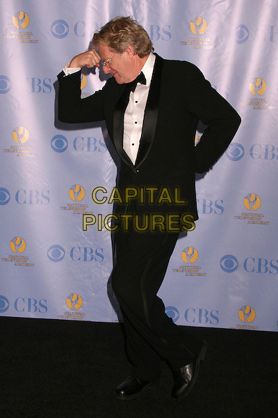 JERRY SPRINGER.34th Annual Daytime Emmy Awards - Press Room at the Kodak Theatre, Hollywood, California, USA, 15th June 2007..full length black suit hands funny pose glasses bow tie.CAP/ADM/BP.©Byron Purvis/AdMedia/Capital Pictures.