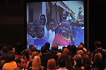 A video montage plays to delegates of the Republican National Convention at an sponsored by World Vision and the One Campaign at the Minneapolis Convention Center in Minneapolis, Minnesota on September 2, 2008.