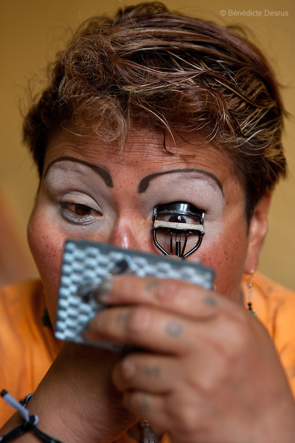 Paola, a resident of Casa Xochiquetzal, puts on makeup before going to work in Mexico City, Mexico on July 10, 2008. When this photo was taken, she was one of the youngest women at the shelter and still worked the streets. On January 1, 2011, she disappeared and never came back. Casa Xochiquetzal is a shelter for elderly sex workers in Mexico City. It gives the women refuge, food, health services, a space to learn about their human rights and courses to help them rediscover their self-confidence and deal with traumatic aspects of their lives. Casa Xochiquetzal provides a space to age with dignity for a group of vulnerable women who are often invisible to society at large. It is the only such shelter existing in Latin America. Photo by Bénédicte Desrus