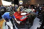 Workers dust off the Fisker Karma S at the Detroit Auto Show in Detroit, Michigan on January 12, 2009.