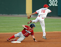 Brian Gump (24) of the Lakewood BlueClaws is forced out at second base as Derrik Gibson (18) of the Greenville Drive completes the inning-ending double play in the second inning of Game 2 of the South Atlantic League Championship Series on Sept. 14, 2010, at Fluor Field at the West End in Greenville, S.C. Photo by: Tom Priddy/Four Seam Images