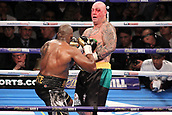 24th March 2018, O2 Arena, London, England; Matchroom Boxing, WBC Silver Heavyweight Title, Dillian Whyte versus Lucas Browne; Dillian Whyte attacks Lucas Browne during the fight sending the Australian backwards