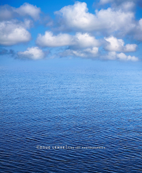 A Blue Rippled Seascape, Sky and Cloud Nature Background