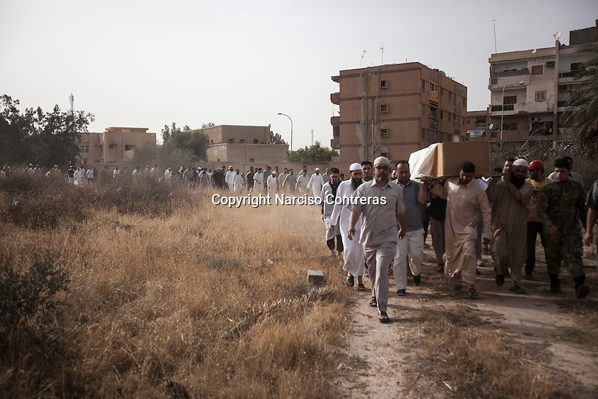Thursday 19, May 2016: Family members, relatives and friends of Ali, an 18 years-old youth killed in a terrorist attack by IS (Islamic State) in Abu Grain, carry out his coffin during his funeral in a graveyard in Misrata City. Ali survived the attack and was taken to a military hospital in Italy, but he died by his injuries later on.