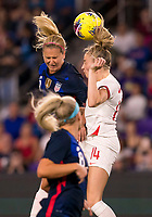 5th March 2020, Orlando, Florida, USA;  England defender Leah Williamson (14) and the United States midfielder Lindsey Horan (9) go up for a header during the Women's SheBelieves Cup soccer match between the USA and England on March 5, 2020 at Exploria Stadium in Orlando, FL.