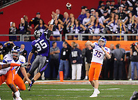 Jan. 4, 2010; Glendale, AZ, USA; Boise State Broncos punter (35) Kyle Brotzman throws a pass on a fake punt play in the fourth quarter against the TCU Horned Frogs in the 2010 Fiesta Bowl at University of Phoenix Stadium. Boise State defeated TCU 17-10. Mandatory Credit: Mark J. Rebilas-