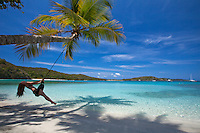 Young woman on a tire swing<br />
