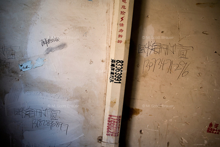 Laborers numbers are painted on a wall in Pukou, Jiangsu, China.