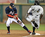Reno Aces' Ronny Cedeno makes the out against Omaha Storm Chasers' Terrance Gore in the Aces'  5-4 win in Reno, Nev., on Sunday, Aug. 24, 2014.<br /> Photo by Cathleen Allison
