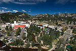 An overview of downtown Estes Park, Colorado with Riverside Plaza and Park Theater Mall on a summer morning