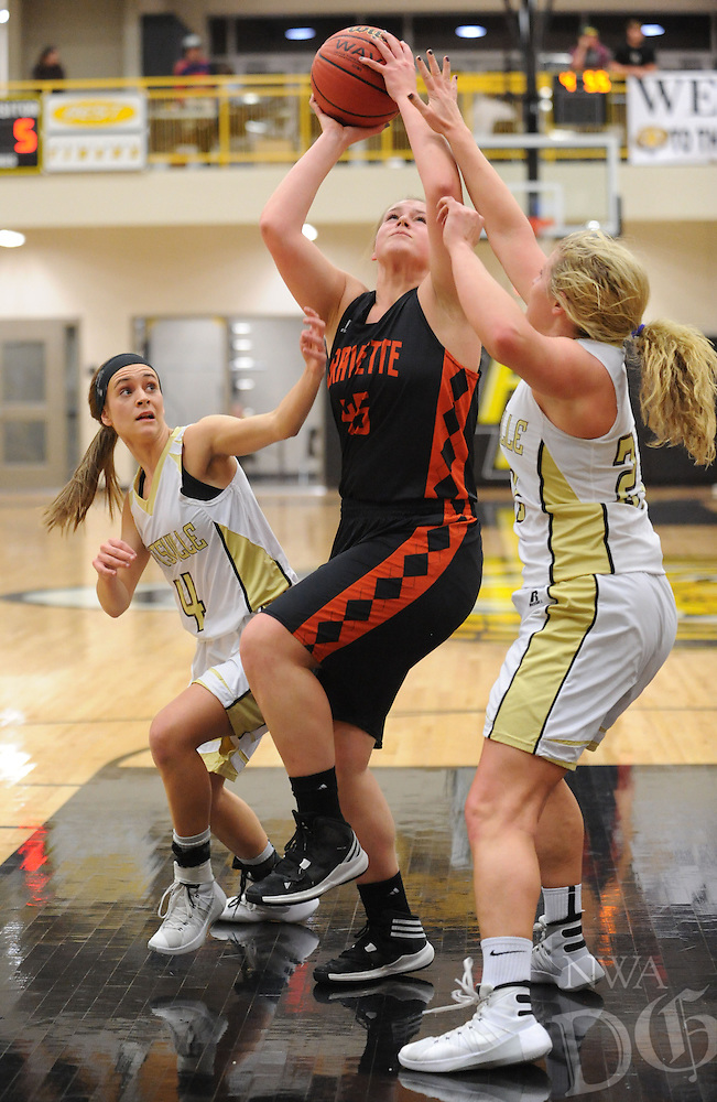 NWA Democrat-Gazette/ANDY SHUPE<br /> Amanda Pinter (center) of Gravette attempts a shot in the lane as she is fouled by Ashley Brannon (right) of Pottsville  as Katie Cormier (left) defends Wednesday, Feb. 24, 2016, during the first half of play in the 4A North Regional Tournament in Tiger Arena in Prairie Grove. Visit nwadg.com/photos to see more photographs from the game.