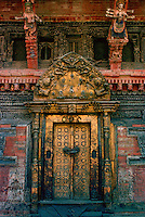 An ornate carved and decorated doorway of a building in Patan - a city famous for such decorative buildings.
