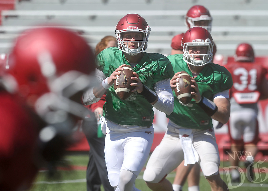 NWA Democrat-Gazette/MICHAEL WOODS &bull; @NWAMICHAELW<br /> University of Arkansas quarterback's Austin Allen (8) and Rafe Peavey (2) run drills during practice Saturday April 2, 2016, at Razorback Stadium.