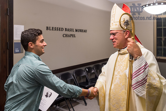 September 8, 2016; Diocese of Ft. Wayne-South Bend Bishop Kevin Rhodes greets residents following the Mass of Dedication of the altar in Blessed Basil Moreau Chapel in Dunne Hall. (Photo by Matt Cashore/University of Notre Dame)