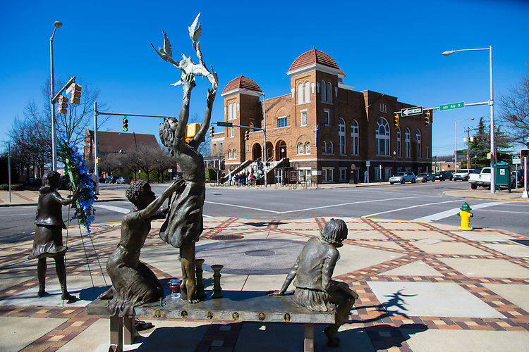 "Kelly Ingram Park, named in 1932 for local firefighter Osmond Kelly Ingram, is a four acre park located in Birmingham, Alabama. In 1992 it was completely renovated and rededicated as ""A Place of Revolution and Reconciliation"" to coincide with the opening of the Birmingham Civil Rights Institute, an interpretive museum and research center, which adjoins the park to the west.  It is bounded by 16th and 17th Streets and 5th and 6th Avenues North in the Birmingham Civil Rights District. The park, just outside the doors of the 16th Street Baptist Church, served as a central staging ground for large-scale demonstrations during the American Civil Rights Movement of the 1960s."