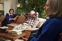 Former Massachusetts governor Michael Dukakis (on couch, right) and his wife Kitty Dukakis (on couch, left) listen as Cynthia Piltch (right), of Lexington, Mass., speaks during support group for people and their family who have had or are thinking about undergoing electroconvulsive therapy (ECT) in their home in Brookline, Massachusetts, USA, on Sun., Dec. 4, 2016. Kitty Dukakis used ECT to treat depression and substance abuse issues. She continues to have ECT treatments about once every seven or eight weeks. Piltch has also received electroconvulsive treatments.