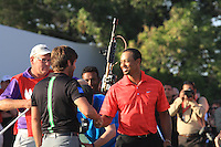 Robert Rock (ENG) and Tiger Woods (USA) on the 18th during the final day of  the Abu Dhabi HSBC Golf Championship, Abu Dhabi GC,Abu Dhabi,United Arab Emirates.Picture Fran Caffrey www.golffile.ie
