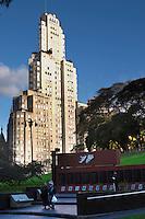 A modern high rise building on in sunshine and in shadow Monument commemorating the Falkland war Islas Malvinas. Plaza San Martin Square renamed Plaza de la Fuerza Aerea or Plaza Fuerza Retiro Buenos Aires Argentina, South America