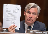 United States Senator Sheldon Whitehouse (Democrat of Rhode Island) holds letter from Mark Judge's lawyer as he makes an opening statement during the US Senate Committee on the Judiciary meeting to vote on the nomination of Judge Brett Kavanaugh to be Associate Justice of the US Supreme Court to replace the retiring Justice Anthony Kennedy on Capitol Hill in Washington, DC on Friday, September 28, 2018.  If the committee votes in favor of Judge Kavanaugh then it goes to the full US Senate for a final vote.<br /> Credit: Ron Sachs / CNP<br /> (RESTRICTION: NO New York or New Jersey Newspapers or newspapers within a 75 mile radius of New York City)