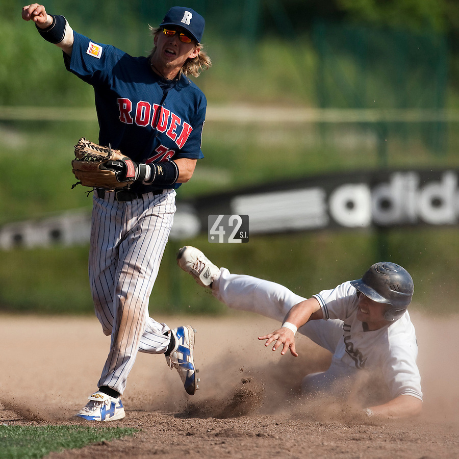 24 May 2009: Luc Piquet of Rouen throws the ball to first base for the double play during the 2009 challenge de France, a tournament with the best French baseball teams - all eight elite league clubs - to determine a spot in the European Cup next year, at Montpellier, France. Rouen wins 7-5 over Savigny.