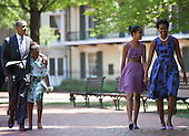 United States President Barack Obama (L) and first lady Michelle Obama (R) walk with their daughters Sasha (2L) and Malia (2R) through Lafayette Square from St. John's Protestant Episcopal Church to the White House July 17, 2011 in Washington, DC.  The First Family attended Sunday services..Credit: Brendan Smialowski / Pool via CNP