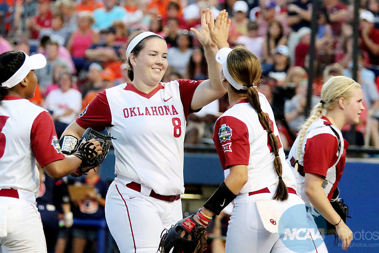 06 JUNE 2016: Paige Parker (8) of University of Oklahoma celebrates after ending the inning against Auburn University during the Division I Women's Softball Championship held at ASA Hall of Fame Stadium in Oklahoma City, OK.  University of Oklahoma defeated Auburn University in Game 1 by the final score of 3-2. Shane Bevel/NCAA Photos