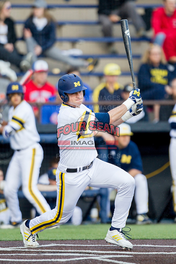 Michigan Wolverines designated hitter Dominic Jamett (41) follows through on his swing against the Eastern Michigan Hurons on May 3, 2016 at Ray Fisher Stadium in Ann Arbor, Michigan. Michigan defeated Eastern Michigan 12-4. (Andrew Woolley/Four Seam Images)