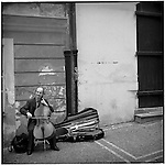A cellist near the Mala Strana plays his instrument, Prague, Czech Republic.