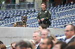 Washoe County Sheriff's Deputy Harris watches a ceremony announcing the addition of a United Soccer League franchise at the Reno Aces Ballpark in Reno, Nev., on Wednesday, Sept. 16, 2015.  <br /> Photo by Cathleen Allison